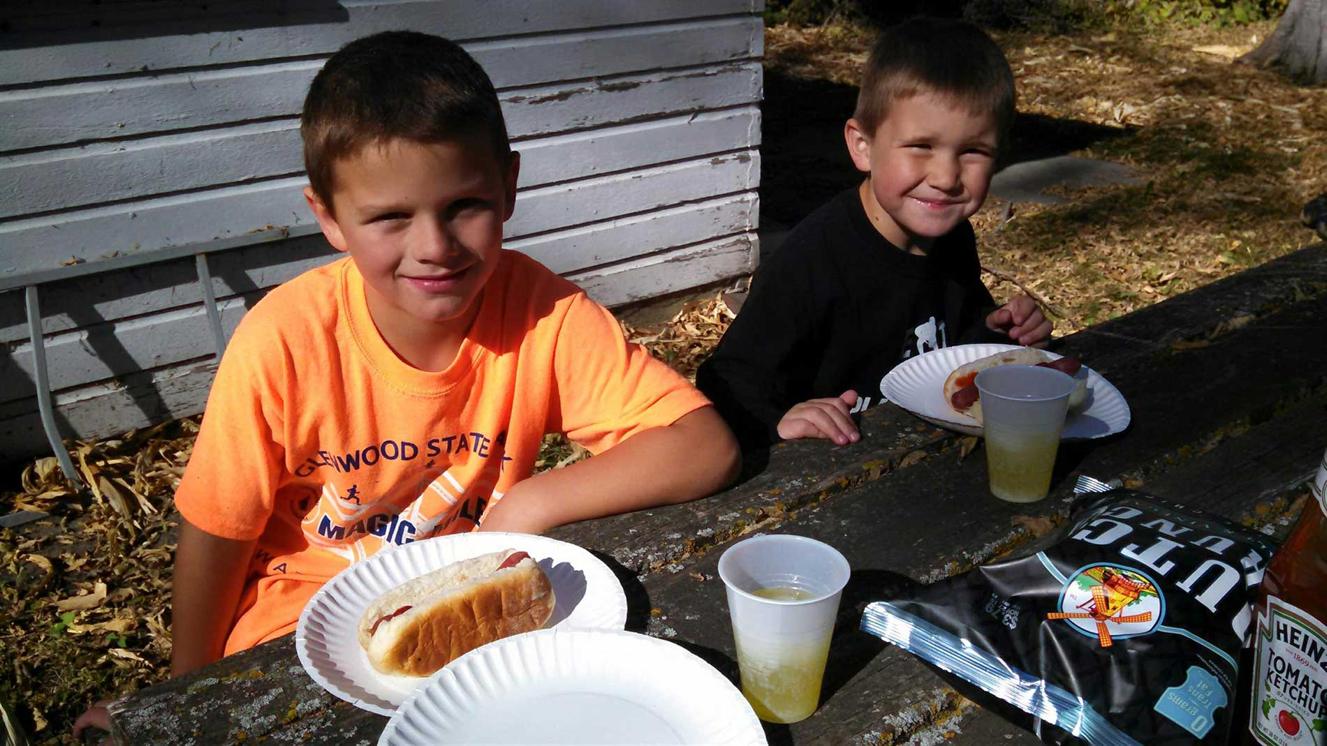 Cole and Reese Enjoying Hot Dogs and Mountain Dew