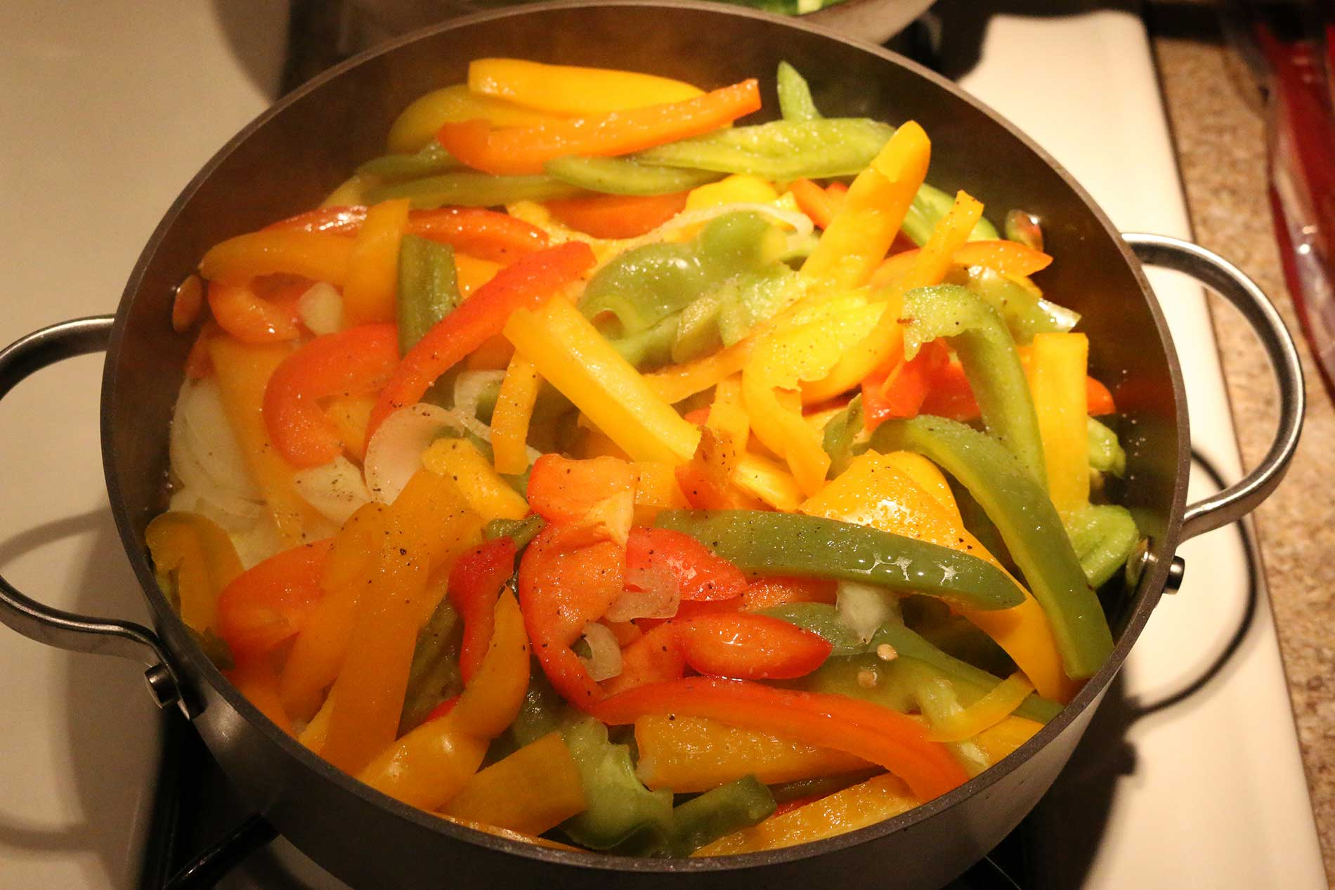 Sauteing the peppers and onions