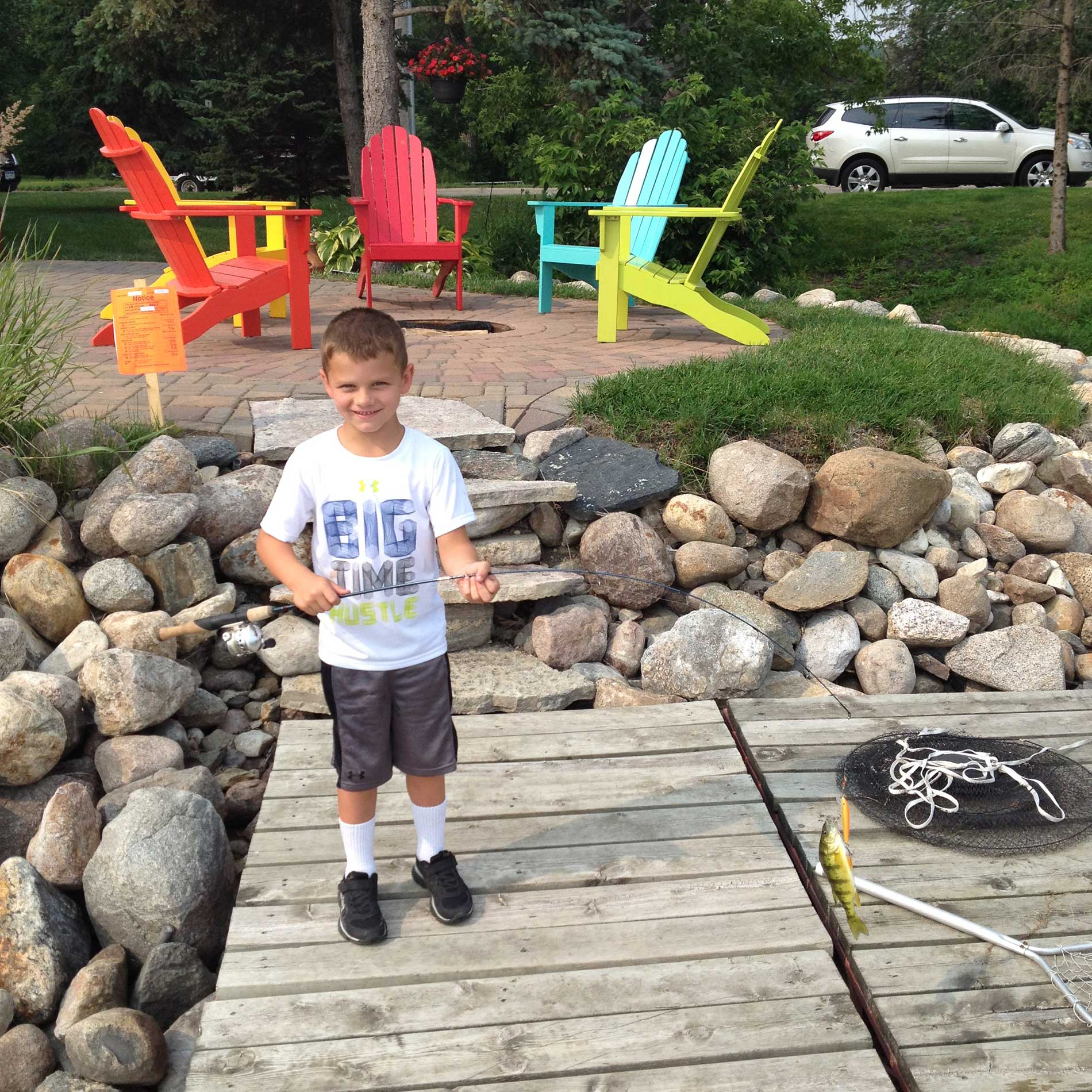 Cole catching a nice perch off of the dock during the summer of 2015.