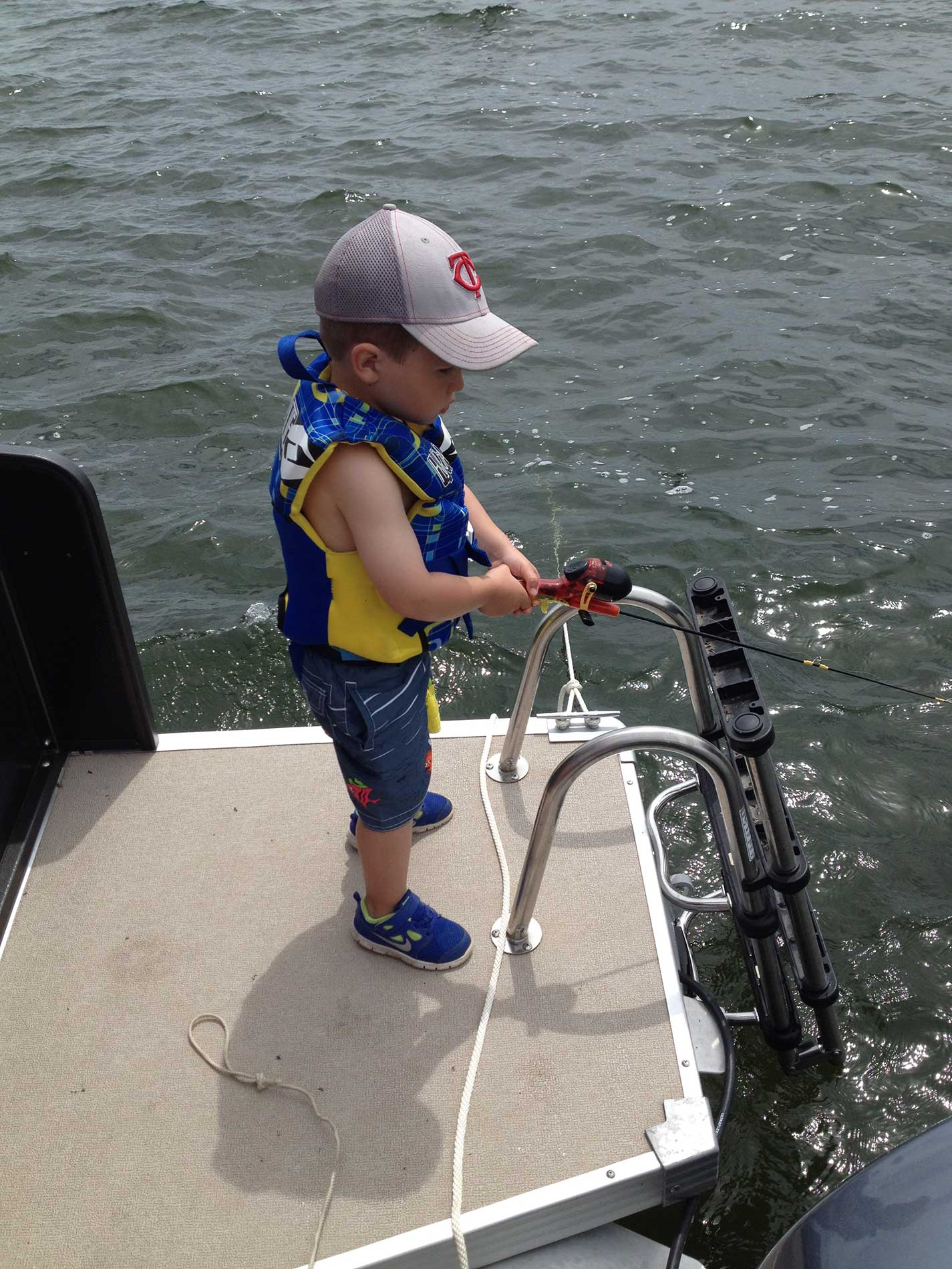 Reese fishing off of the pontoon during the summer of 2014.