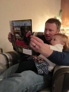 Brinley And I Reading Petersen's Bowhunting Magazine