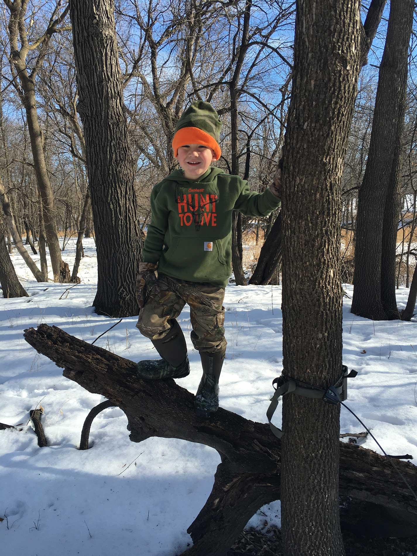 Reese Climbing a Fallen Tree