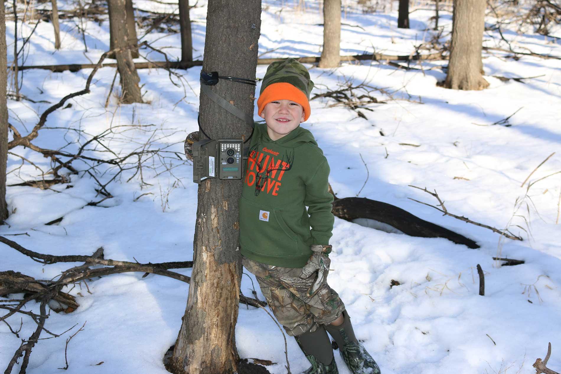 Raising Checking the Trail Camera