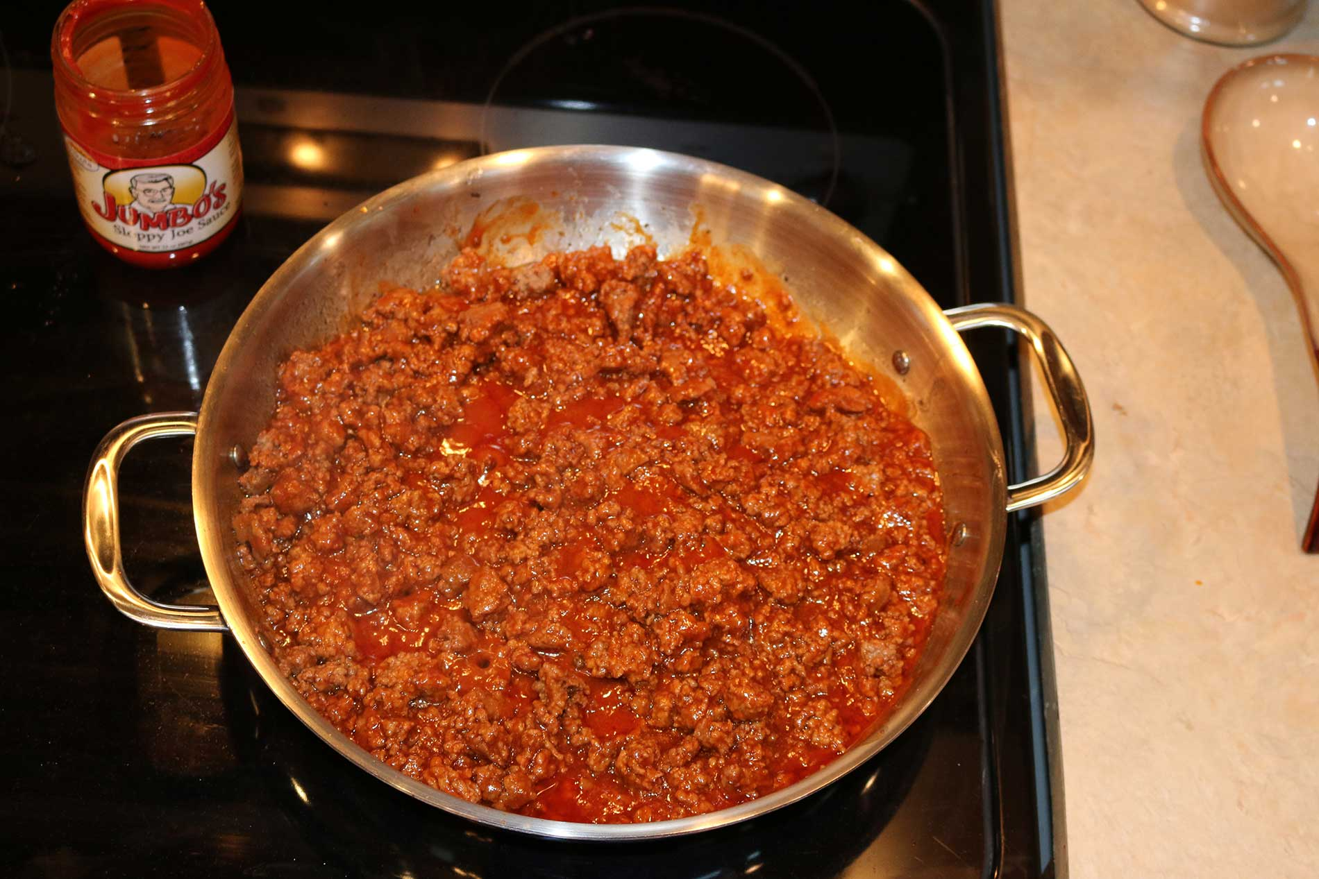 The meat and sauce being brought to a simmer.