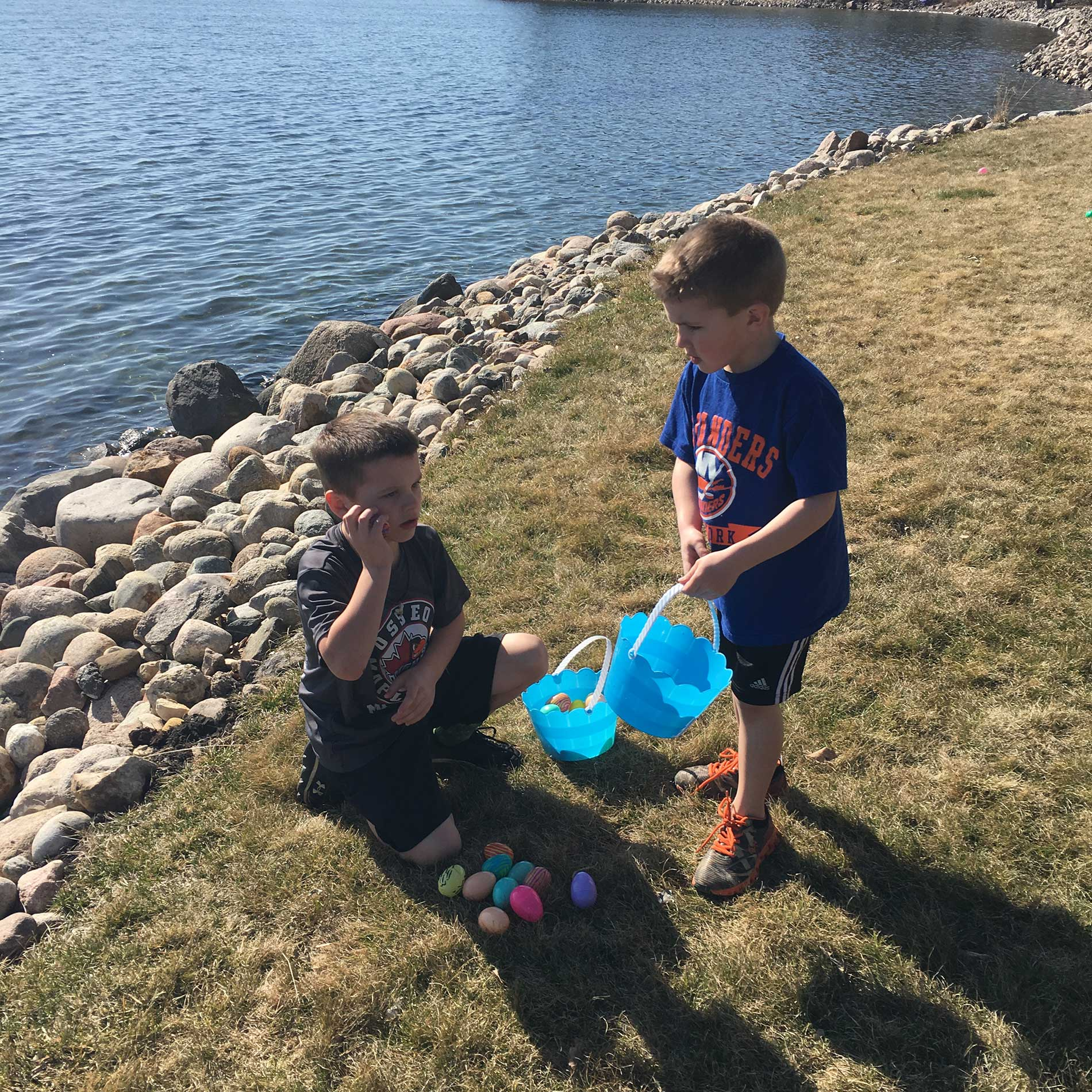 Cole and Reese checking the eggs for candy
