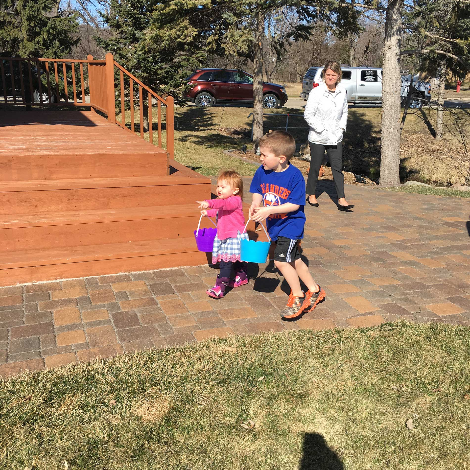 Reese and Brinley racing for eggs