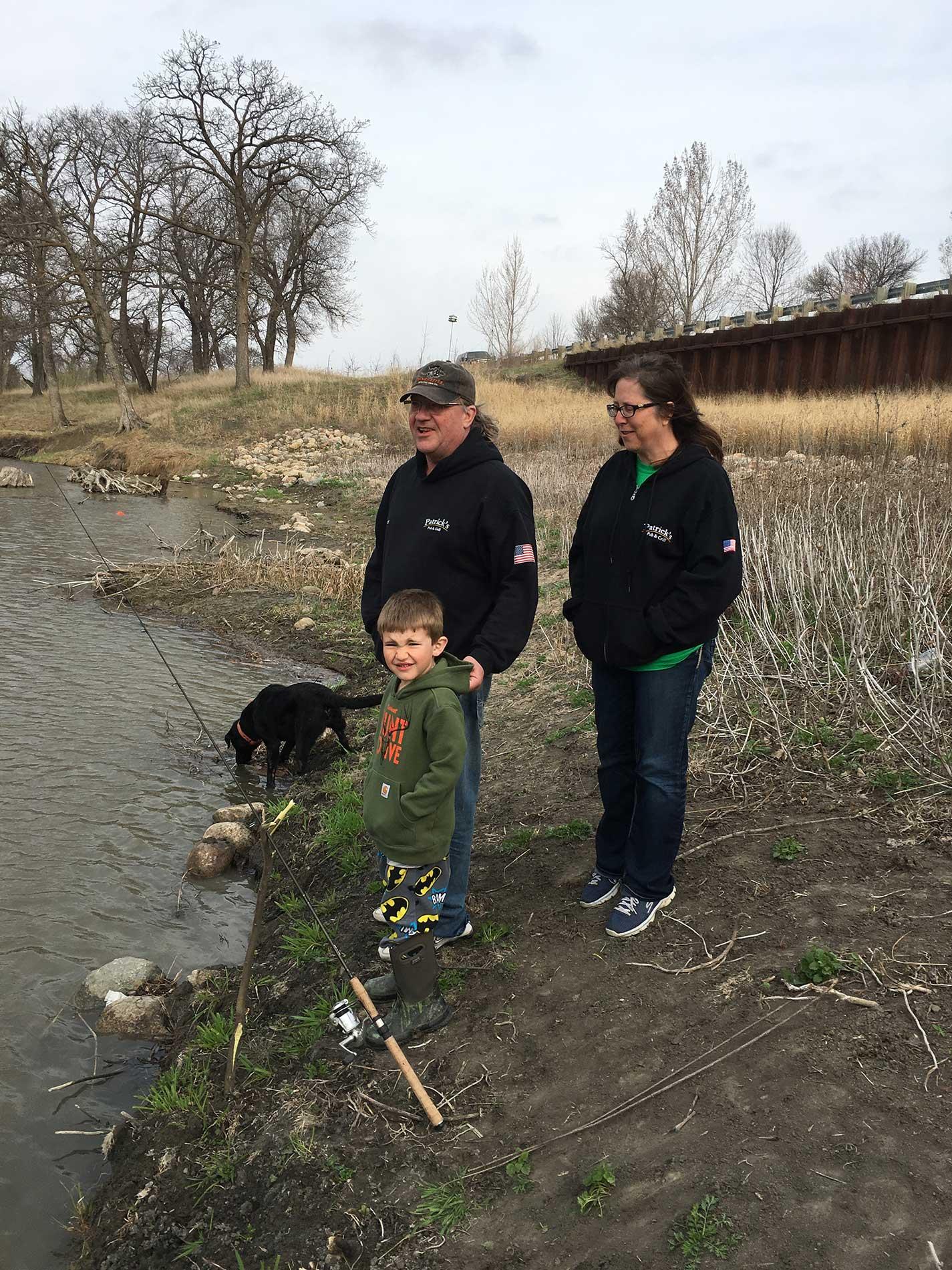 Grandpa and Grandma fishing with Reese
