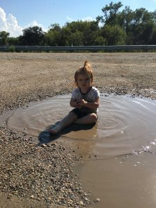 Brinley all defiant in the mud puddle