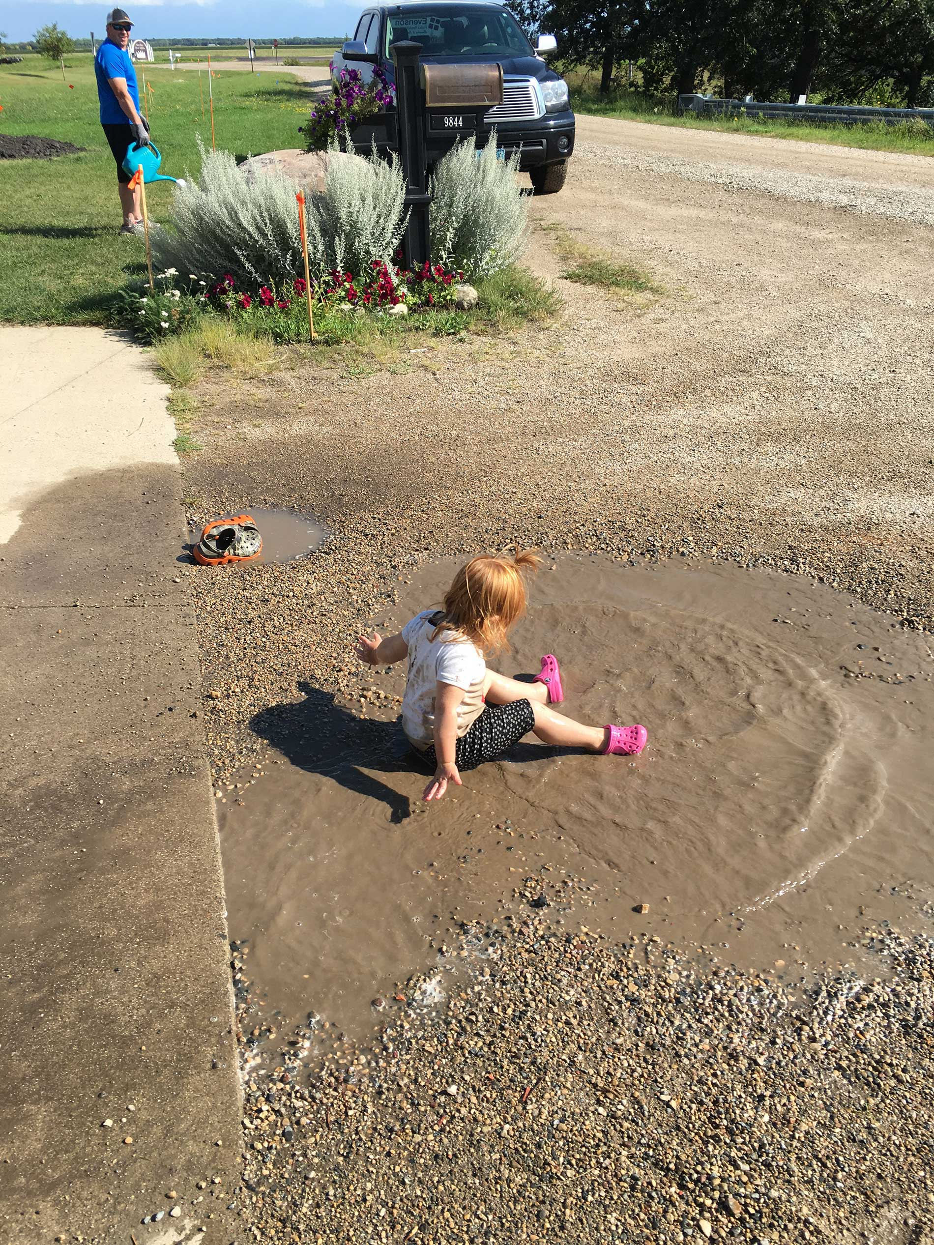 Brinley plopped down in the puddle